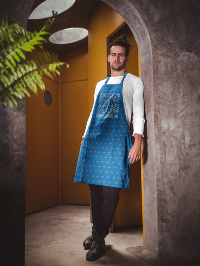 Portrait of a Man Wearing an Apron Mockup Leaning Against a Wall a19880