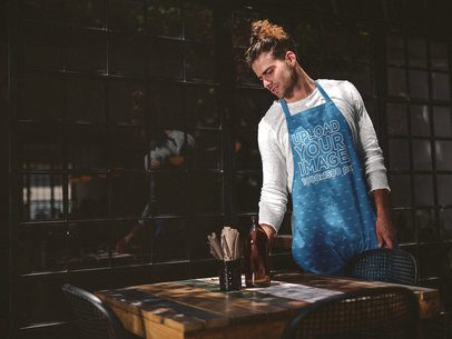 Man Wearing an Apron Mockup Cleaning the Table a19865