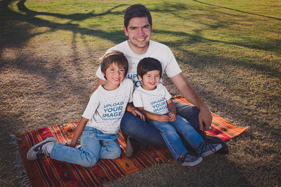 Dad with his Kids Wearing Tshirts Mockup at a Park a20191