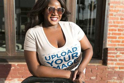 Happy Black Woman Wearing a Plus Size Tee Mockup Outside a Bricks House a18221
