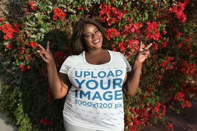 Woman Wearing a Plus Size Tee Mockup Against Red Flowers a18224