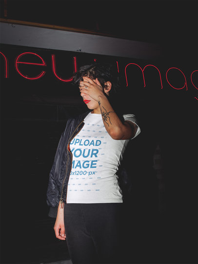 Woman Wearing a Tshirt Mockup Outside a Tattoo Shop at Night a18924