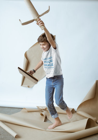Kid Playing with Cardboard Toys Wearing a T-Shirt Mockup a19483