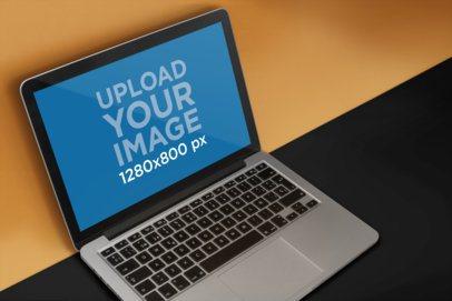 MacBook Mockup Near a Multicolored Wall 20339a