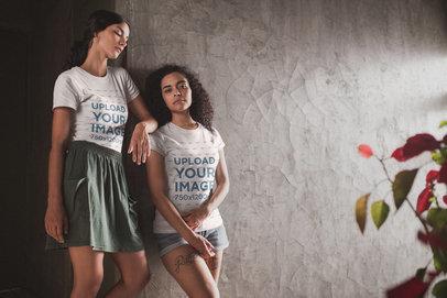 Interracial Teens Wearing T-Shirts Mockup Near a Plant a20095