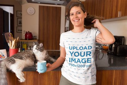 Happy Woman Wearing a T-Shirt Mockup with her Cat at the Kitchen a18971