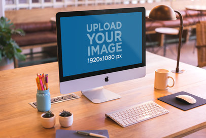 Mockup Featuring an iMac Set Up on a Beautiful Wooden Desk a20415