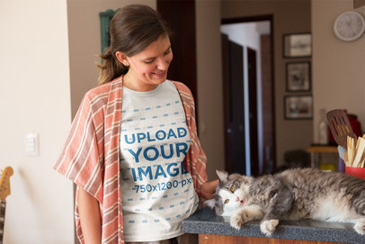 T-Shirt Mockup of a Woman Caressing her Cat at Home a18978