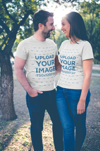 Portrait of a Happy Couple Wearing T-Shirts Mockup at the Park a20610