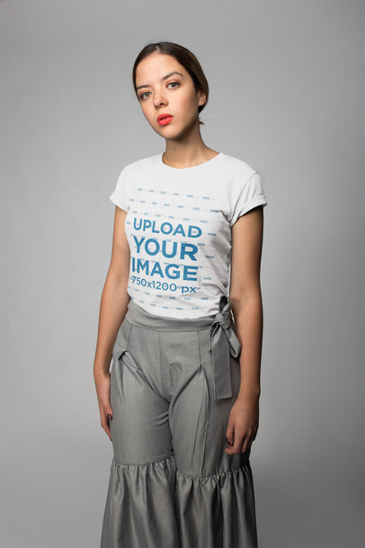 Woman with Red Lips Wearing a Tshirt Mockup in a Photo Studio a18684