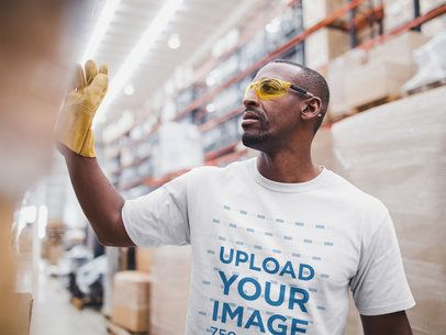Warehouse Worker Wearing a T-Shirt Mockup a20387