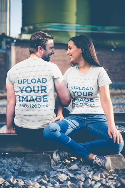 Happy Couple Wearing T-Shirts Template While Sitting on a Railway a20612