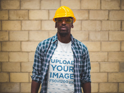 Serious Worker Wearing a T-Shirt Mockup and a Blue Plaid Shirt a20984