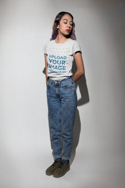 Hispanic Girl Standing in a Photo Studio Wearing a Tshirt Mockup a18721
