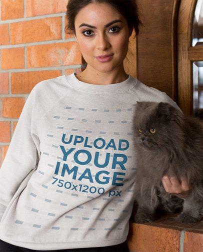 Portrait of a Woman Wearing a Crewneck Sweatshirt Mockup Holding her Cat a18785