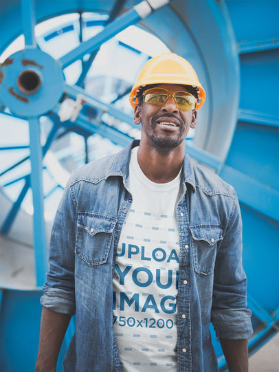 Smiling Industrial Worker Wearing a Tshirt Mockup a20391