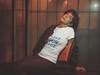 T-Shirt Mockup of a Hispanic Woman Leaning on a Window at Night a18898