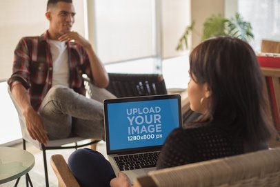 Girl Using a MacBook Mockup Interviewing a Man a20767