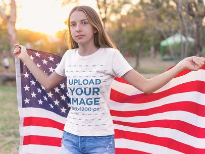 Teen White Girl Wearing a T-Shirt Mockup while Holding the American Flag a20708