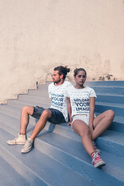 T-Shirt Mockup Featuring a Young Hipster Couple Sitting on Steps a20586