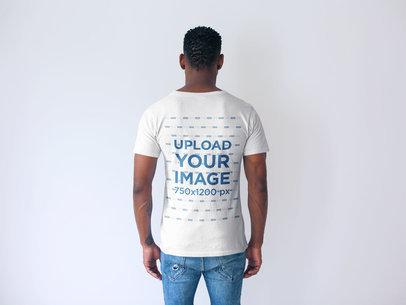 Back Shot Tshirt Mockup of a Man Facing a White Wall 20739
