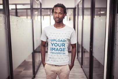 Black Man with Short Dreadlocks Wearing a T-Shirt Mockup at the Office a20520