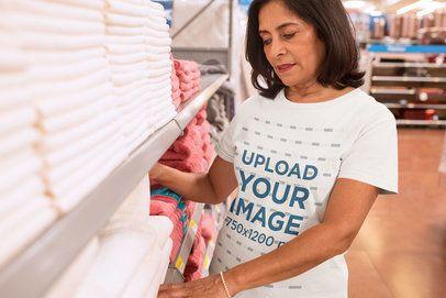 Elder Woman Choosing Towels Wearing a T-Shirt Mockup a20353