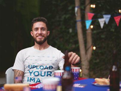 Happy Man Wearing a Tshirt Mockup at a 4th of July BBQ Party a20834