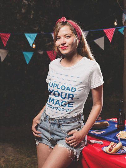 Smiling Girl Wearing a Tshirt Mockup at a 4th of July BBQ Party va20827