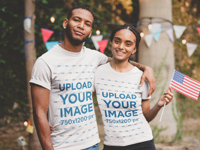 Smiling Black Man and Woman Wearing a Tshirt Mockup at a 4th of July Party a20831