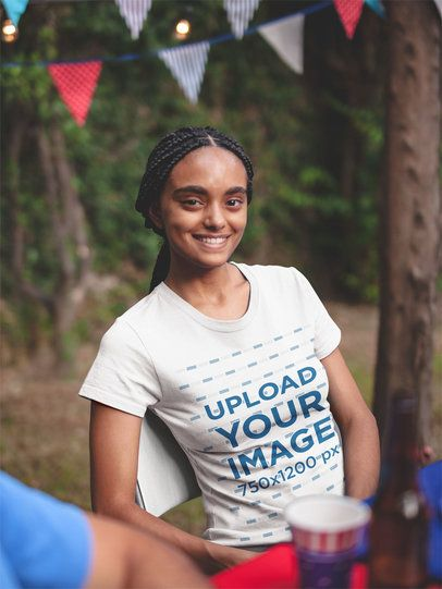 Black Girl with Braids Wearing a Tshirt Mockup at a 4th of July BBQ Party a20833