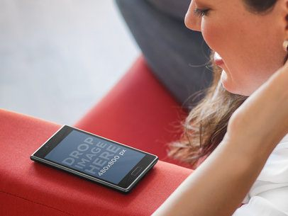 Woman Staring at LG Optimus L7 on Red Couch