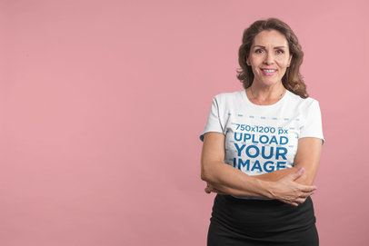 Smiling Woman Wearing a Tshirt Mockup in a Solid Color Room a20372