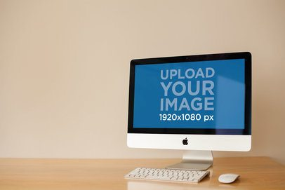 Angled iMac Mockup Standing on a Wooden Desk a20816