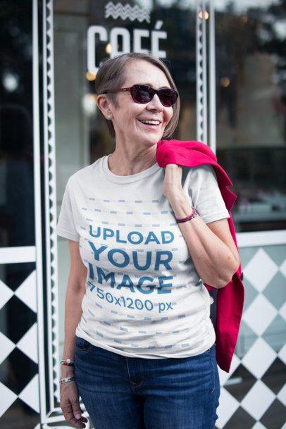 Smiling Stylish Senior Woman Wearing a Tshirt Mockup on the Street a20664
