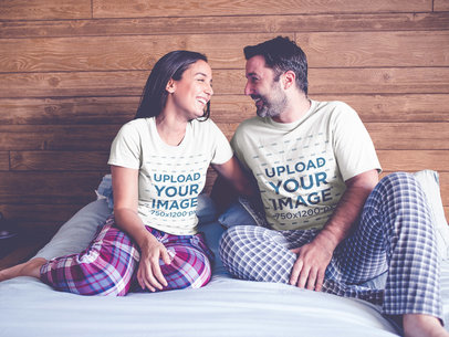 Couple Wearing T-Shirts Mockup Sitting on Their Bed a20601
