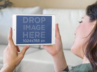 Woman Using iPad Mini at Living Room