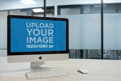 iMac Mockup Standing with Wireless Keyboard and Mouse in a Corporate Office a20970