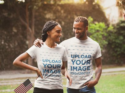 Happy Couple Wearing T-Shirts Mockup During the 4th of July a20830