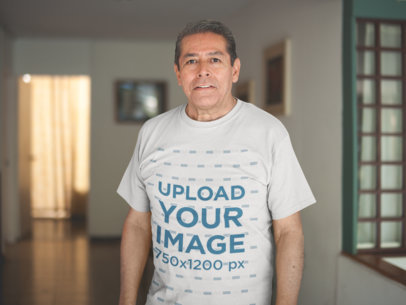 Senior Man Wearing a Tshirt Mockup in the Living Room a20656