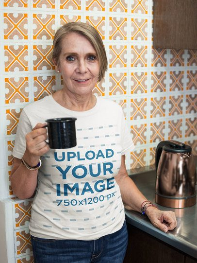 Senior Woman Wearing a T-Shirt Mockup While Having a Morning Coffee a20658