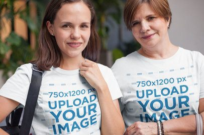 Daughter and Mom Wearing T-Shirts Mockup Taking a Walk Downtown a20726