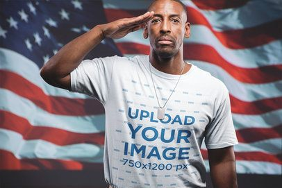 Veteran Soldier Wearing a T-Shirt Mockup Saluting Against the Flag a20923