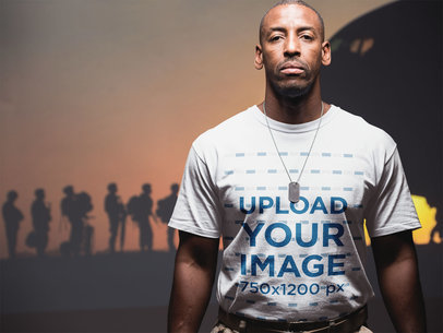 Veteran Wearing a Round Neck Tee Mockup Against a Picture of the Army a20926