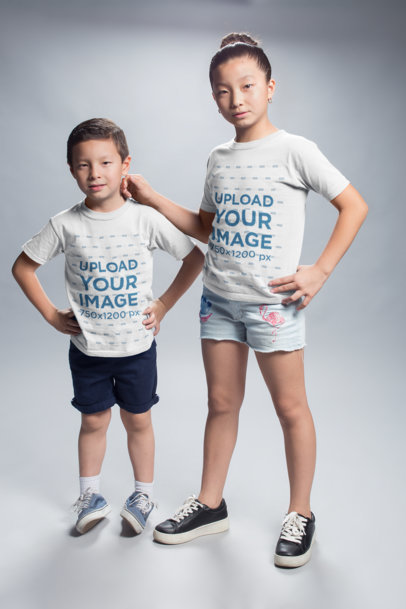 Sister and Brother Wearing T-Shirts Mockup at a Photo Studio a20946