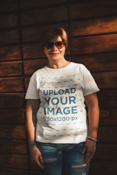 Woman Wearing a Tshirt Mockup Standing Against a Wooden Wall a20728