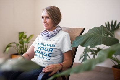 T-Shirt Mockup of a Senior Lady Looking to the Window a20659