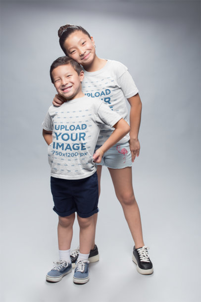 Happy Asian Kids Wearing Round Neck Tees at a Photo Studio a20947