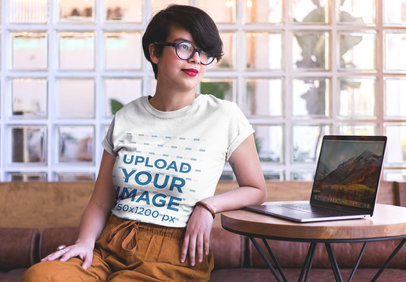 Bored Woman Wearing a T-Shirt Mockup Waiting for a Coworker a20403