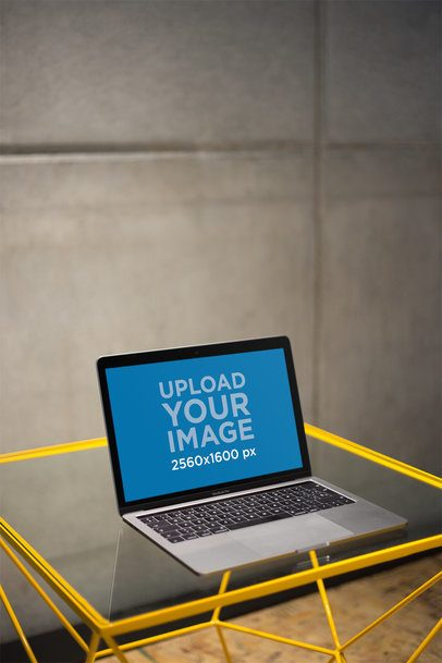 MacBook Mockup Standing on a Glass Desk a21163